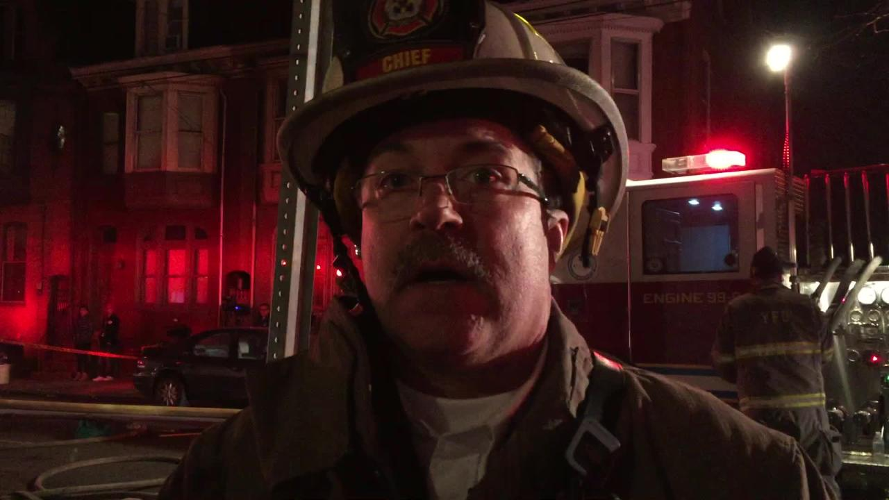York City Fire Chief David Michaels describes rescues from a house fire Tuesday evening on West Philadelphia Street.